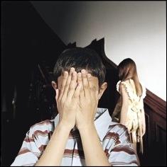 Boy hiding eyes